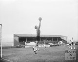 The goalkeeper of the visiting team catches the ball at Twerton Park, c.1963