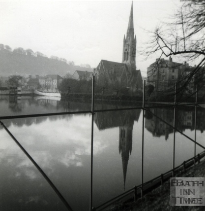 St Johns Roman Catholic Church reflected in flooded North Parade Cricket Ground. Jan 1966
