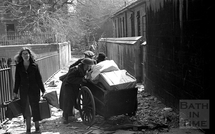 An elderly couple are helped moving their possessions along Bridewell Lane, Bath, April 1942