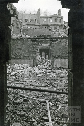Looking through the damaged Assembly Rooms towards the burnt out corner of the Circus, Bath, April 1942