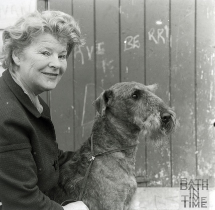 Mrs. M.E. Harmsworth of Bathampton and her prize winning Airedale Terrier.