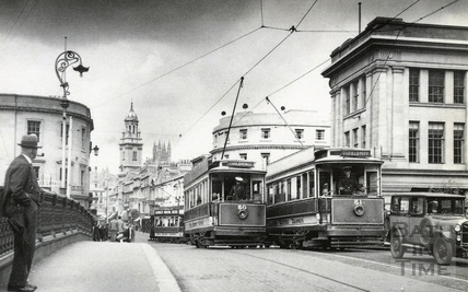 Tram cars Nos 50 and 51 cross on the Old Bridge c.1935