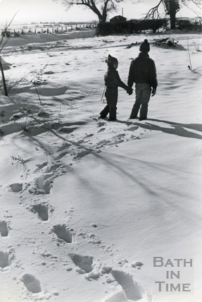 Two children walking in the snow, 18 Jan 1982