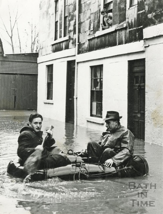Paddling by in a dingy during the floods c.1960