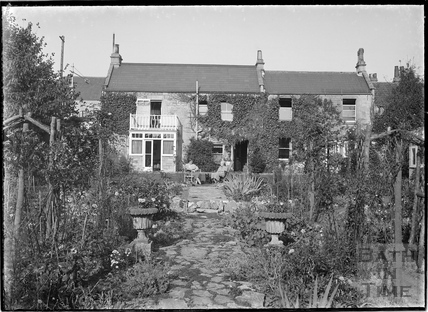 Unidentified House with two people posing in the garden, Combe Down (?) c.1930s