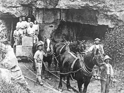 Quarrymen exitingthe Tump Quarry at Westwood with horses and stone, c.1880s
