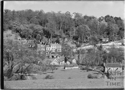 View of Iford Manor and gardens from hill opposite c.1920s