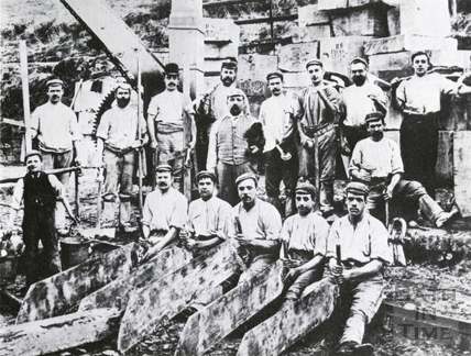 Quarrymen and their tools line up for this group portrait c.1900?