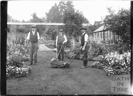 Three gardeners in the back garden of an unidentified house c.1910