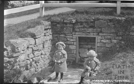 The photographer's twin boys at Conkwell Wishing Well c.1914