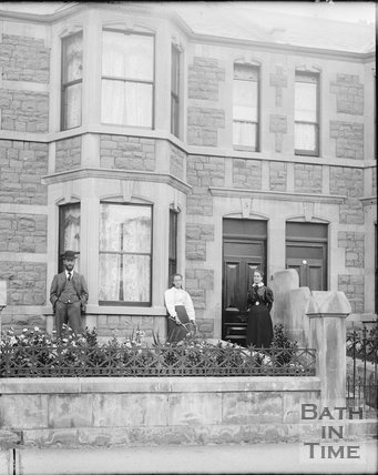A family pose outside no 5 Pulteney Terrace, Pulteney Road, c.1920s