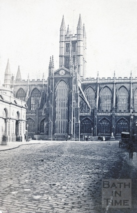 Bath Abbey from the High Street, showing the corner of the old market c.1870