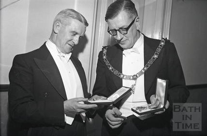 Mayor of Bath Cllr Gallop and the City Clerk inspect the medals awarded to them by Emperor Haile Selassie, Oct 18 1954