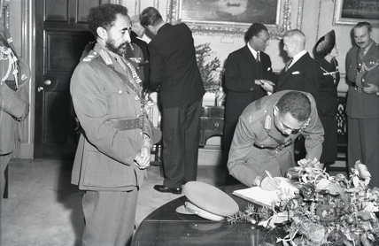 Haile Selassie's son Prince Makonnen, Duke of Harar signs the visitor's book in Bath, 18th Oct 1954