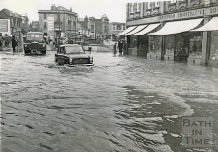 Waterlogged cars in a flooded Chippenham High Street, 1960
