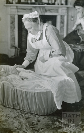 Nurse Dance, the nurse for the photographer's twin boys, shortly after their birth in 1911.