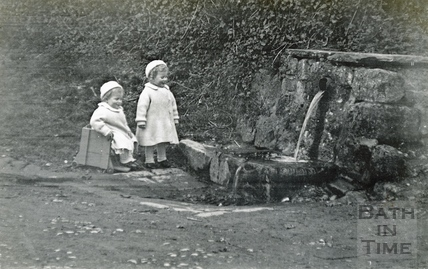 The photographer's twins at the wishing well, Horseshoe Walk, 1913