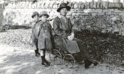 The photographer's wife Violet in a fetching netted hat posing with her twin boys c.1916