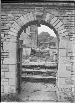View through stone arched gateway, The Close, Biddestone 1933