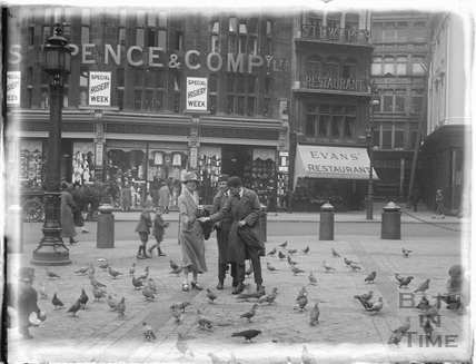 Feeding the pigeons during a trip to London 1926