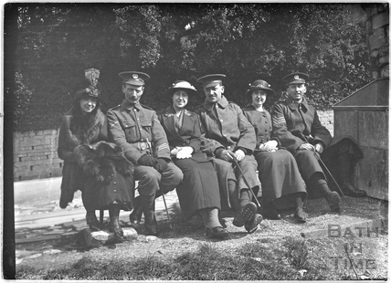 Members of 12th Hants posing with some women, Bath, c.April 1915