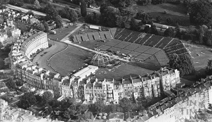 1992 Aerial view of the Royal Crescent seen from behind, showing the lawn being set out for a major event 27 June