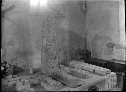 Saxon Cross and relics inside the Church of the Holy Cross, Ramsbury, near Marlborough Wiltshire, c.1920s