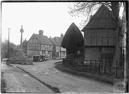 Memorial and timber framed house, thought to be Wantage, Oxfordshire, c.1930s