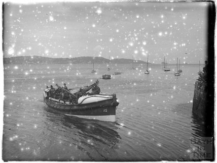 A lifeboat and lifeboatmen near Paignton, Devon, late 1920s