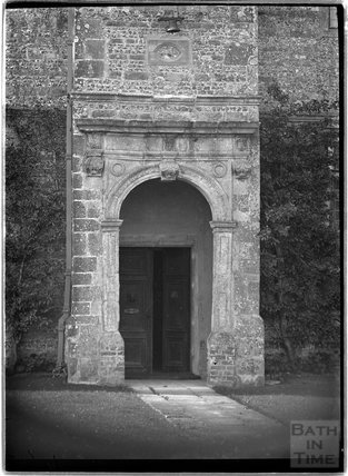 Arched doorway to Upper Upham House, near Swindon, Wiltshire, c.1920s