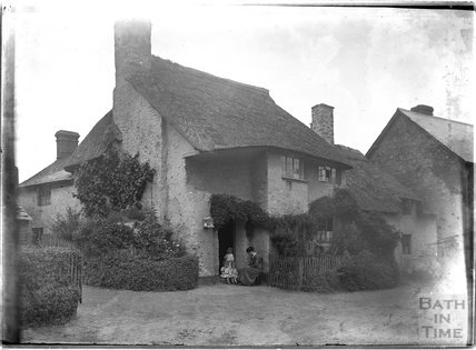 Sitting outside a thatched cottage, Minehead, Somerset c.1905 - 1915