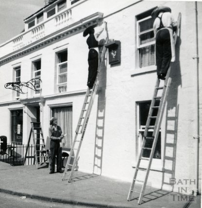 Painting the outside of the Larkhall Inn, c.1960s