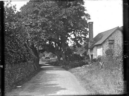 An unknown building on a country lane c.1900s