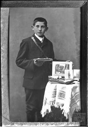 Portrait of a young man with some photographs c.1890s