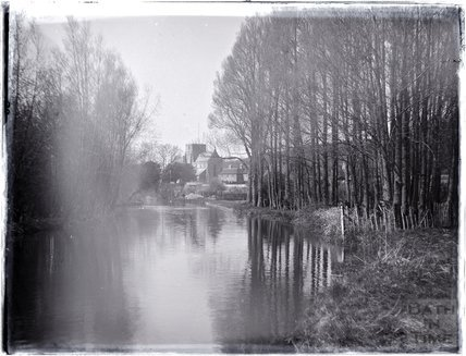 Riverside scene at Heytesbury, Wiltshire, with the church of St Peter & St Paul in the distance, c.1920s