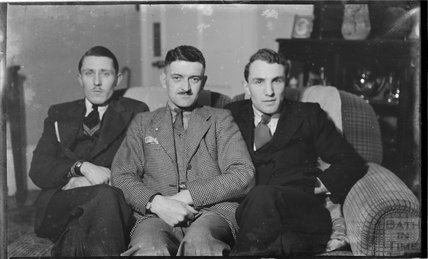 Three unidentified young men posing for the camera c.1919