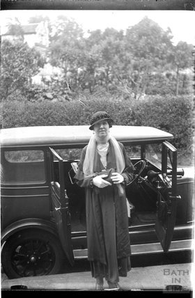 An unidentified lady and car c.1920s