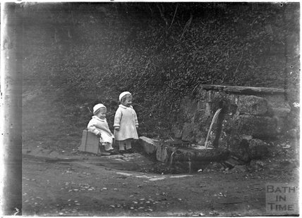 The photographer's twins at the Wishing Well, Horseshoe Walk 1913
