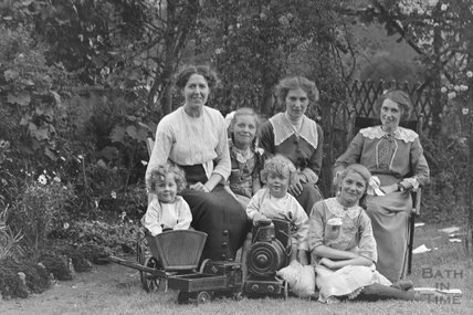 Friends and family of the Photographer in their garden in Sydney Buildings c.1913 - detail