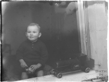 David Russell, a young boy and his toy LMS locomotive, c.1910s
