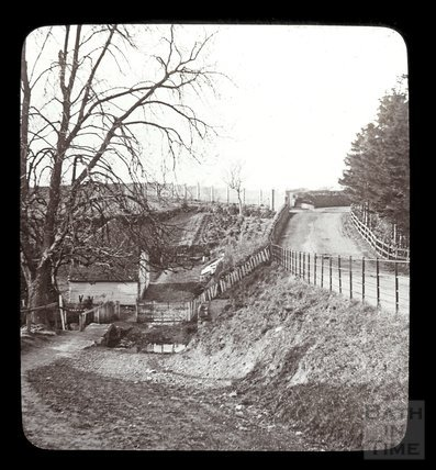 Unidentified rural lane with a turning to a ford and small bridge, c.1900s