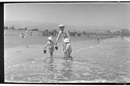 The photographer's wife Violet and twins on the beach at Minehead 1914