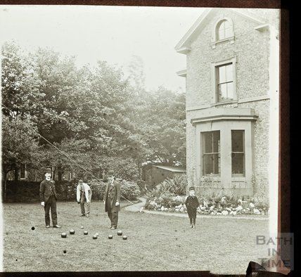 Playing lawn bowls in an unidentified garden, c.1890s