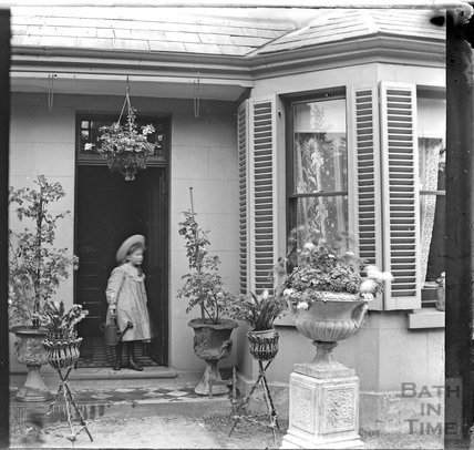 Young girl outside an unidentified house c.1890s