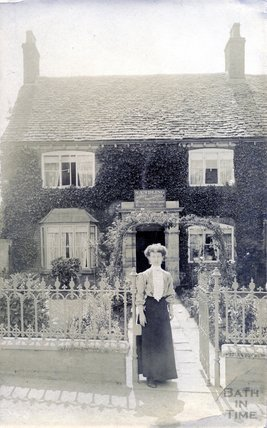 Lady outside a house in Dudbridge, near Stroud, c.1890s