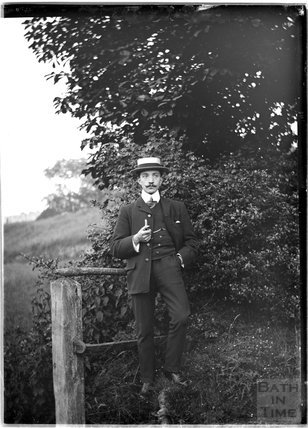 Portrait of a young man smoking a pipe c.1900s