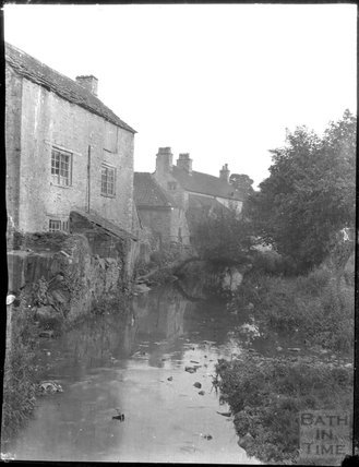Houses in Nunney, viewed across the stream, c.1900s