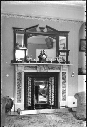 Fireplace in an unidentified sitting room