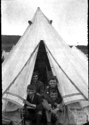 Youths in a tent, unidentified location, c.1920s