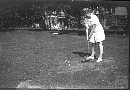 A young girl playing croquet, unidentified location, c.1950s